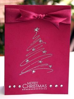 Red Christmas card with a silver tree