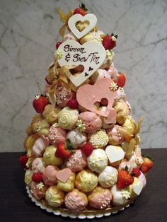 Whimsical Croquembouche by Sliceofcake.deviantart.com - like it too! prob different colours