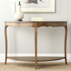 Combining the tradition of the half-moon style table with a gentle, romantic touch, the Christina console updates a hallway or entryway with its firewood palette.