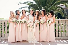 Pink Bridesmaid Dresses | Photography: Laurie Bailey Photography. Read More:  http://www.insideweddings.com/weddings/oceanfront-wedding-ceremony-classic-romantic-ballroom-reception/854/
