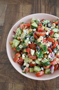 Mediterranean chickpea salad with cucumber, cherry tomatoes, feta and olives.