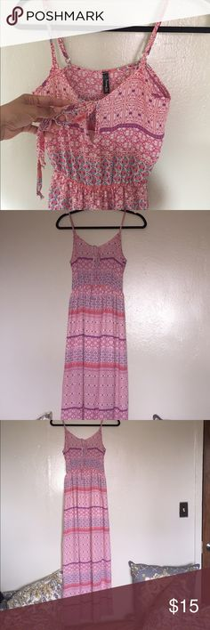 Pink Maxi dress Pink, purple and light blue print maxi dress. Elastic waist and half lined. Keyhole design in the front of the dress. Dresses Maxi