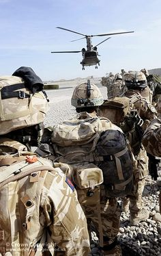 Soldiers wait to board a Royal Air Force Chinook helicopter during Operation Banbarac 3 in Afghanistan.