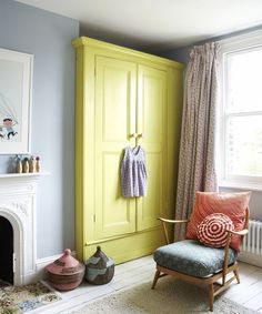 Kids bedroom with bright yellow wardrobe from Design Bloggers at Home book. Photograph by Rachel Whiting.: