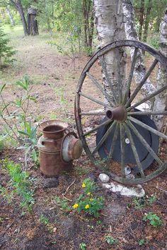 Rusty Milk Can And Wagon Wheel