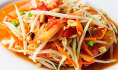 Som Tum (Spicy Green Papaya Salad) - Sprung from the fields of northeast Thailand (Isan), this amazing dish is one of those foods that mean much more than a good meal - it is a way of life.