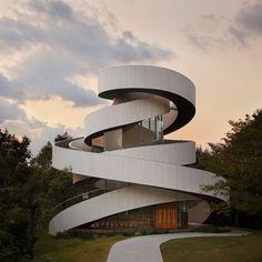 Curving staircases encircle this wedding chapel by Tokyo-based architect Hiroshi Nakamura, meeting at a rooftop platform overlooking Hiroshima's coastline.