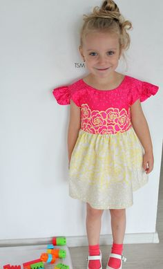 Love sewing for little girls? Learn to sew an adorable, sweet dress for a little girl using this easy to follow, step by step flutter sleeve dress tutorial.