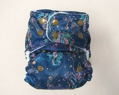 We got your little ones bum covered by PrairieRoseBaby on Etsy Cloth Diapers, Vera Bradley Backpack, Little Ones, You Got This, Etsy Seller, Unique, Cover, Creative, Bags