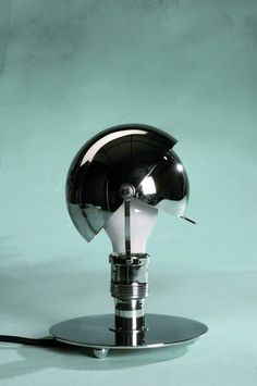 This Carl Jucker Table Lamp was designed by the famed Bauhaus industrial designer in 1923. Abiding to Gropius' teachings, Jucker endeavored to create lamps that were durable, beautiful and affordable.