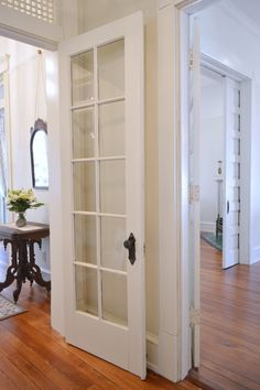 Foyer. Entryway Vestibule - French Doors - Morgan Ford Southern Romance House in Mobile, Alabama - Renovation by Phantom Screens