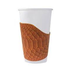 Embossed Python Coffee Huggies - The Perfect Mix of Fashion and Function! NOW in Python    Sleek and chic our new leather coffee cup sleeve will give a new touch to your favorite morning ritual.