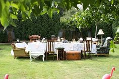 Set up a long table, covered with all different kinds of teapots, mismatched teacups and saucers, Combine normal sized teacups with some huge ones (like a flower planter)...