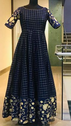 Gorgeous blue color floor length chcked dress with floral design boarder and sleeves. Ready to ship Price : 6500 INR. To order whatsapp 7013728388 . Kalamkari Dresses, Ikkat Dresses, Party Wear Indian Dresses, Indian Gowns Dresses, Designer Anarkali Dresses, Designer Dresses, Designer Wear, Casual Dresses, Fashion Dresses