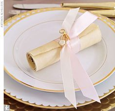 A La Carte  When it comes to impressing your guests, it's all about the details. A rolled up letterpressed menu tied with ribbon and adorned with a vintage pin is not only functional, it can also serve as a keepsake.  Menu scroll by Ceci New York; pl...