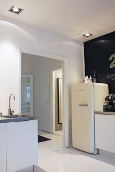Really like the one dark feature wall, the downlights AND the smeg (of course)
