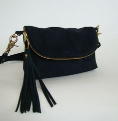 Black Suede 3-in-1 Bag, small suede cross-body bag, clutch, or large wallet with removeable strap and leather tassel, made to order. $98.00, via Etsy.