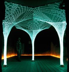 """We've developed illuminated, self-supporting animated architectural textiles using an old textile technique, lace making, that's brought up to an architectural scale then combined with parametric design software to create some very ephemeral light installations. by Loop.pH studio"