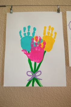 Springtime handprint flowers - easy, and a nice change from the tulips we often do! From pinkieforpink