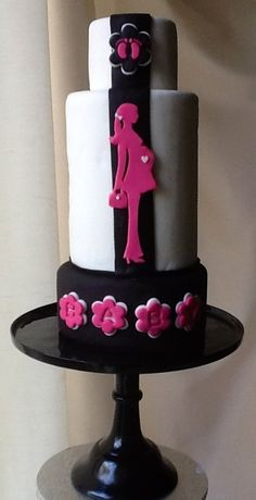 Pink , Black and White Pregnant Lady Baby Shower Cake. I love the special detail of the bottom cake, with the flower and you can add the name.