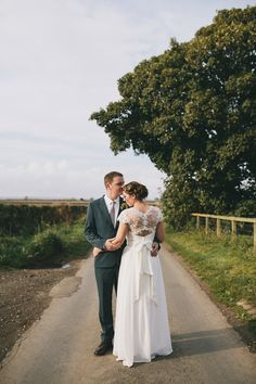 An elegant rustic Autumn wedding with a bride wearing flowers in her hair.