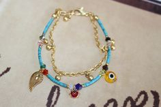 Turquoise Afghan Bead Ethnic Bracelet with Gold par MonroeJewelry, $19.60