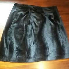 """Vintage Faux Fur Mini Skirt Vintage, black faux fur mini skirt. This skirt is in great condition and sadly doesnt fit me. It doesnt have a size tag, so the measurments are as follows:  Waist- 28"""" Hip- 38"""" Length- 15.5"""" Vintage Skirts Mini"""