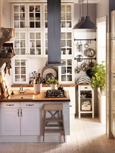 High expectations. Its such a pretty little kitchen, too bad i would have to keep a stool in there at all times in order to reach anything above the first cupboard!