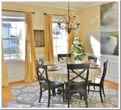 From drab to fab, @Kim Wilson -Sand & Sisal adds some white paint and a few other changes and has turned her boring dining room into a show piece. {Gray and Yellow Dining Room}