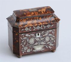 REGENCY MOTHER-OF-PEARL INLAID TORTOISESHELL TEA CADDY -  The flattened domed and hinged top opening to two lidded recesses, the front with flower-filled jardinière, on brass ball feet. 6 x 7 in.