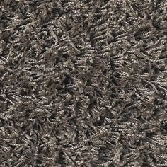 This brown area rug is made from 100% Recycled Polypropylene . This shag carpet features pile 47mm high , which is the perfect length for to get that great shag feel without the mess of a very long pile shag carpet.