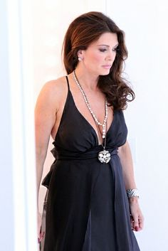 Lisa Vanderpump proved that wedding dresses don't have to be white for her vow renewal. This one of kind bride is anything but oridinary! Click though for more of her special day.