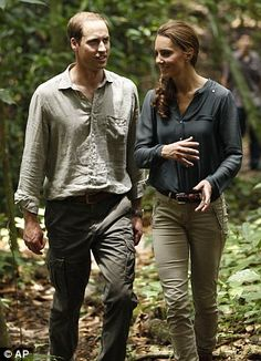 Smiling: The Duke and Duchess of Cambridge walk through the rainforest in Borneo's Danum Valley research centre in Sabah today