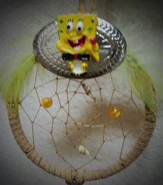 Check out this item in my Etsy shop https://www.etsy.com/listing/240720794/yellow-cartoon-dream-catcher