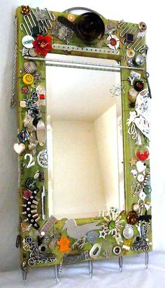 Quirky cool junk gallery mirror frame - Obtainium Art featured on I Love That Junk. Soooo cool!