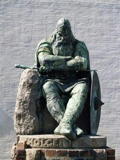 Holger Dansk (Holger the Dane). This is Denmark's hero.  He never lost a battle in his life. He was a mercenary for the Franco-Roman court. An excellent warrior. He embodied the rigor and percervierence of the true Viking spirit. When he missed Danmark he walked from France to Danmark and sat to rest.  And there he sits at the Castle Kronborg in Helsingor Danmark, resting. . .  He vowed that he will awaken when Danmark is in trouble.