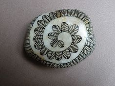 oeuvresverotib: galets - painted rock with Zentangle type design.  I love the base paint on the rock... looks like the inside of a shell.