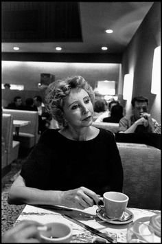 Inge Morath  Los Angeles. 1959. French-born author Anais NIN, sips coffee in Schwabs Drugstore.