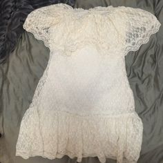 Ruffle Lace Dress Off white colored lace dress with ruffle at the top and bottom. Form fitting. Strapless Moda International Dresses Strapless
