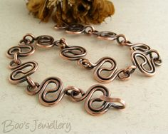 Antiqued copper bracelet featuring squiggle shaped by BooJewels