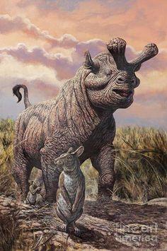 Un Megacerops y dos protoliebres Paleolagus. Oligoceno de Norteamérica. Por Mark Hallett.