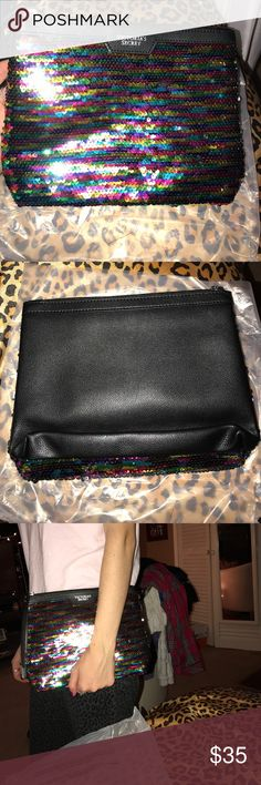 Sequined Victoria Secret Bag Never used.. brand new Victoria secret bag. Medium sized.. all different colored sequins. Comes in packaging !! Front is sequined and back is black leather. Great for a night out bag or travel! Bags