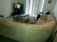 Clean khaki couch with pull out bed in jberrys Garage Sale in