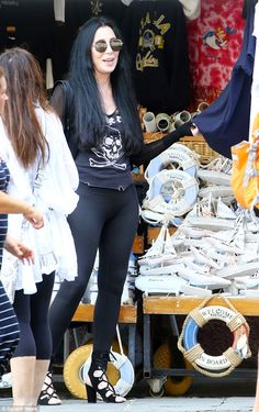 Tourist: Cher checked out the gifts at the market stalls, filled with local souvenirs
