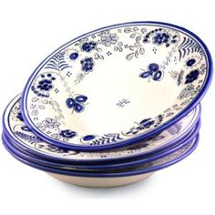 Set of 4 Shallow Pasta Bowls - Blue 'Flor' Design. Painted by Hand, Dishwasher Safe. Was $174.80  SALE PRICE: $139.6 ---- This set of broad, shallow bowls is ideal for serving various kinds of pastas and cannelloni. They also are just right for serving consommé, crèmes and other hot soups.    This set of four marries traditional hand-painted designs with a modern high fired lead-free glaze. The pattern was inspired by an artist in the famous ceramic village of El Puente del Arzobispo.
