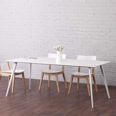 's Airfoil Table is both visually stunning and versatile in its uses. Incorporate into the interior design of a dining room, conference room or restaurant for a chic modern aesthetic. Extendable Dining Table, Dining Table Chairs, Dining Area, Dining Room, Slab Table, Contemporary Dining Table, Reclining Sectional, Under The Table, Modern Interior Design