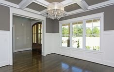 Dining Room wall color is Mink by SW.  I matched the ceiling with a metallic wall paper. Coffer ceiling and wainscotting.