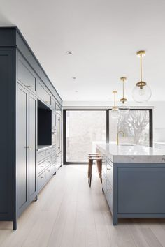 Robitaille Curtis pairs dark and light hues in renovated Montreal kitchen