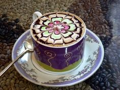 A colorful cup 'o' petals, for one | The 40 Most Amazing Examples Of Coffee FoamArt