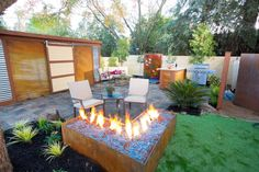 Fire Pit Design Ideas | Outdoor Spaces - Patio Ideas, Decks & Gardens | HGTV #PinMyDreamBackyard  I would LOVE a fire pit on my patio...this style or one of yours I've pinned also.